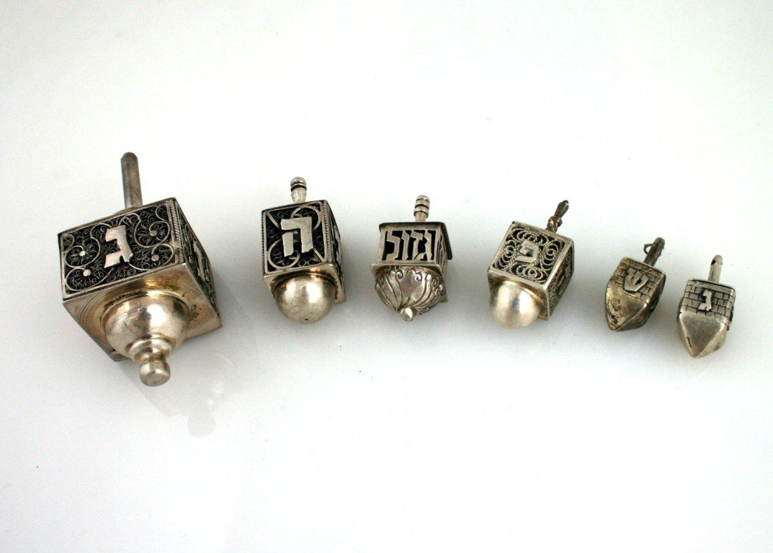 69: A COLLECTION OF SIX STERLING SILVER DREIDELS. Israe