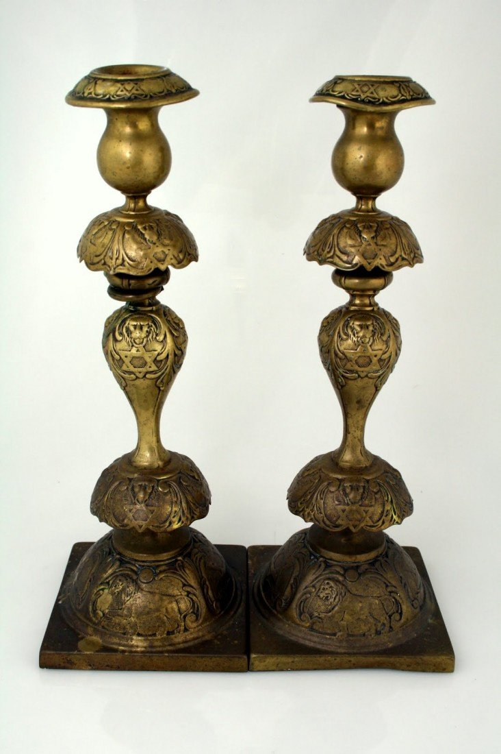 12: A RARE PAIR OF BRASS JUDAICA SABBATH CANDLESTICKS.