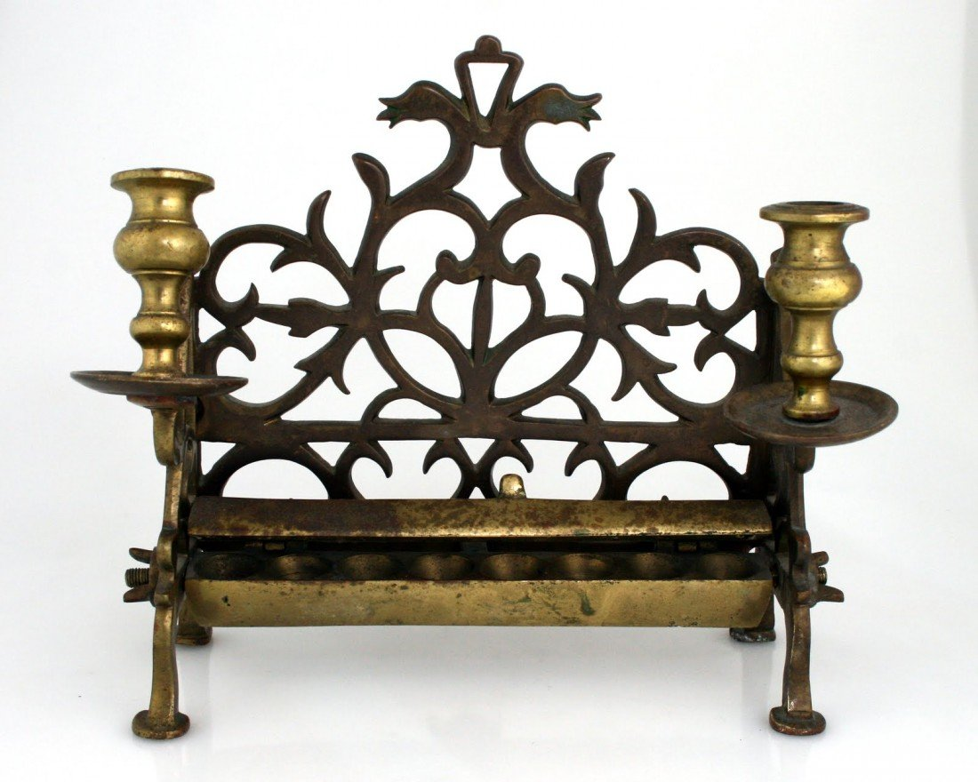 93: A BRASS CHANUKAH LAMP. Poland, c. 1860. On four leg