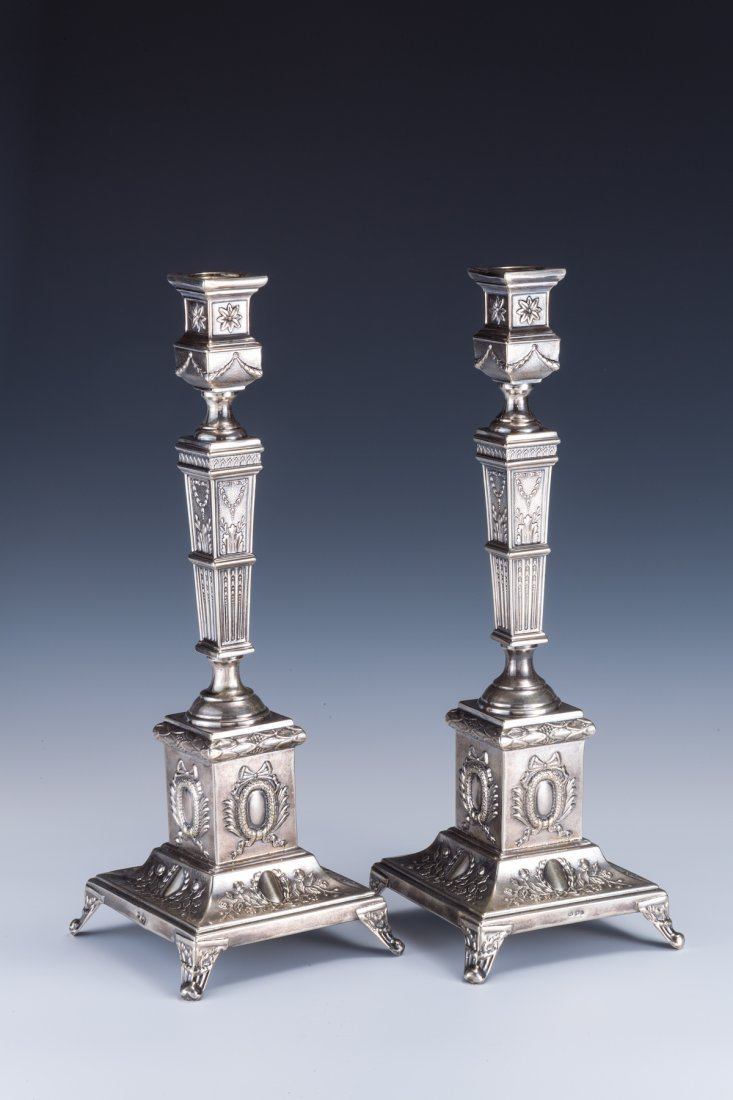 21: A PAIR OF LARGE SILVER CANDLESTICKS BY SZEKMAN