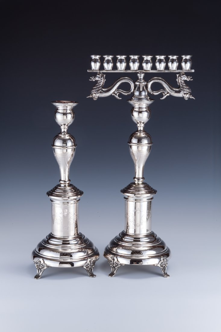 24: A PAIR OF SILVER CANDLESTICKS WITH MENORAH