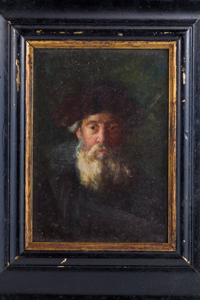 26: A OIL ON BOARD PAINTING OF A RABBINICAL FIGURE.