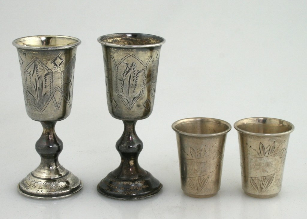 11: FOUR SILVER SMALL KIDDUSH CUPS. Poland and Russia,
