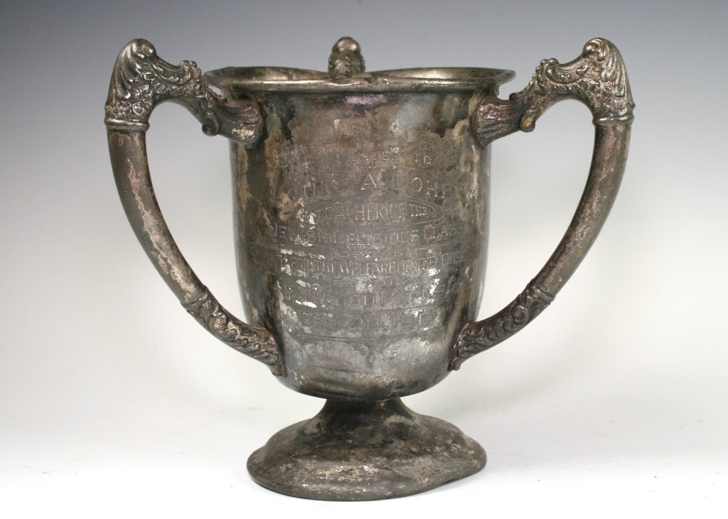 12: A PEWTER TROPHY AWARD. United States, 1915. Three h