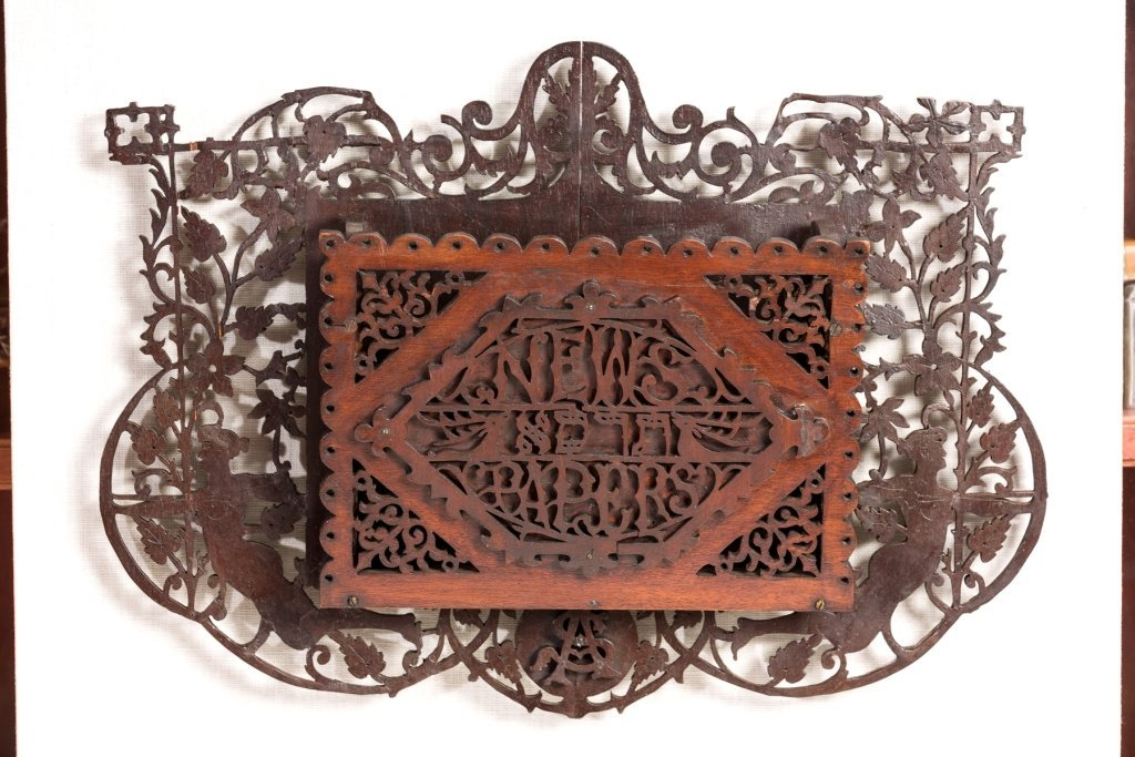 A RARE AND IMPORTANT CARVED WOOD NEWSPAPER HOLDER. Unit