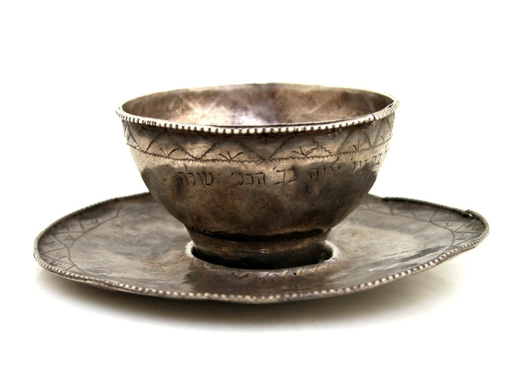 AN EXCEPTIONALLY RARE SILVER KIDDUSH CUP AND UNDERPLATE