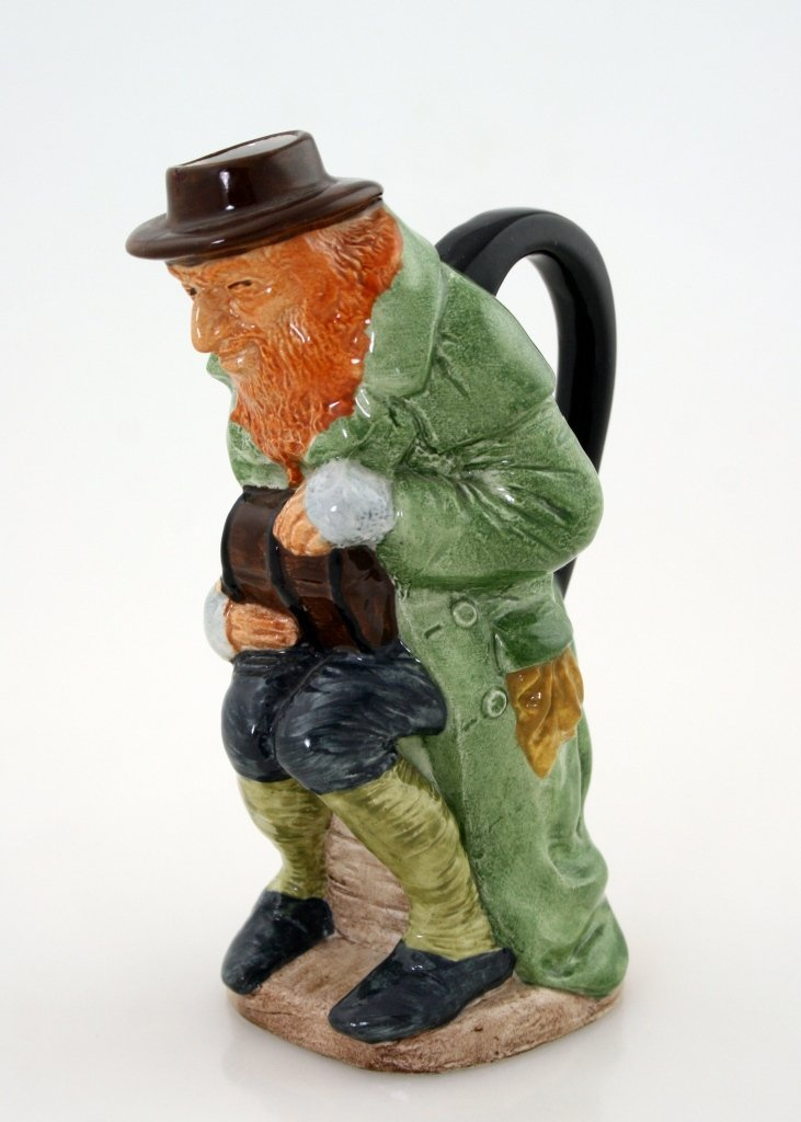 A CERAMIC FIGURE OF FAGIN BY WOOD AND SONS. England, 20
