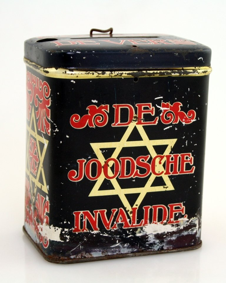 A TIN CHARITY BOX. The Netherlands, c. 1920. Collecting