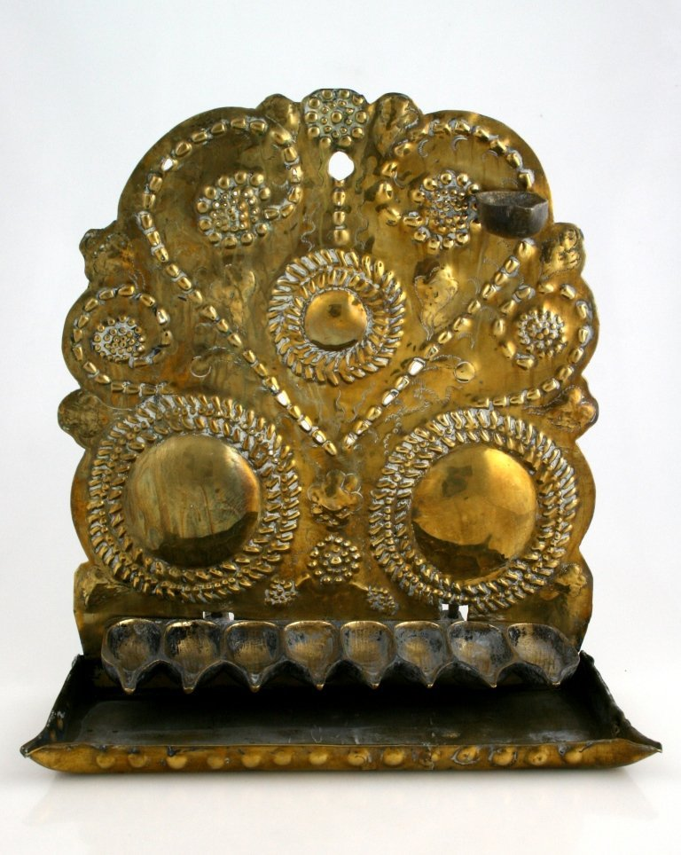 A BRASS SHEET METAL CHANUKAH LAMP. Dutch, 18th century.