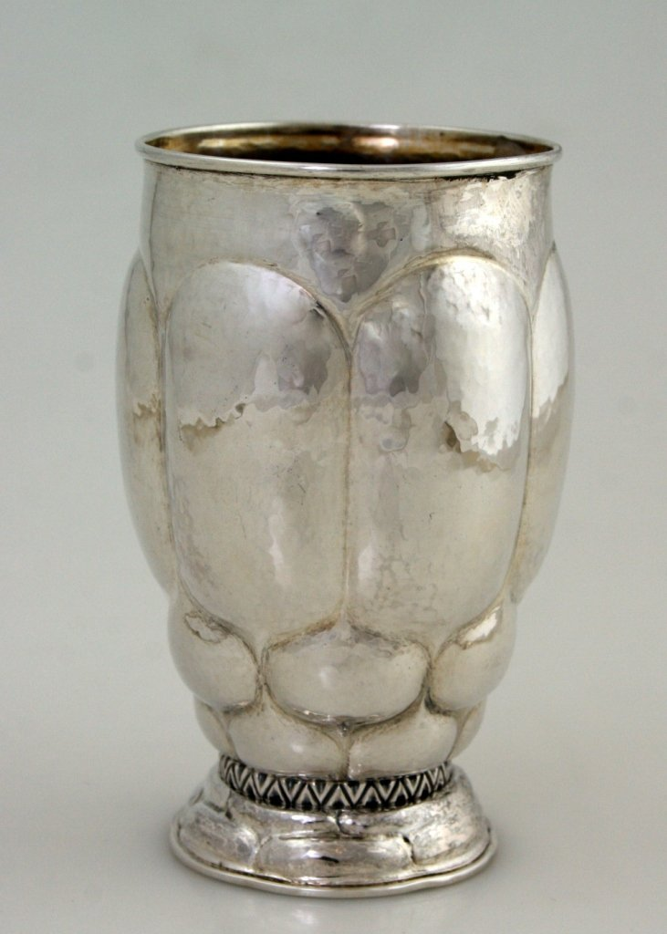 A HAND HAMMERED MODERNIST SILVER CUP. Probably Danish,