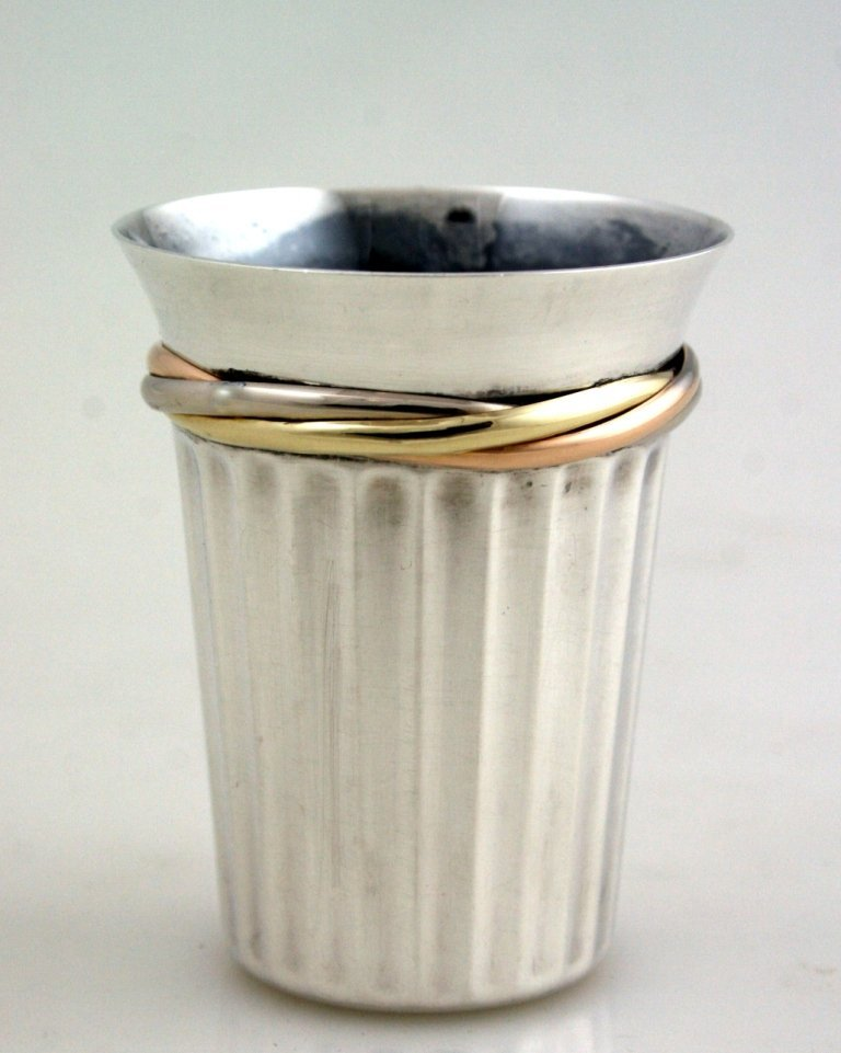 A SILVER AND GOLD SHOT CUP BY CARTIER. 20th century. Ma