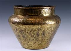 A LARGE BRASS PLANTER. Persian, 20th century. Chased wi