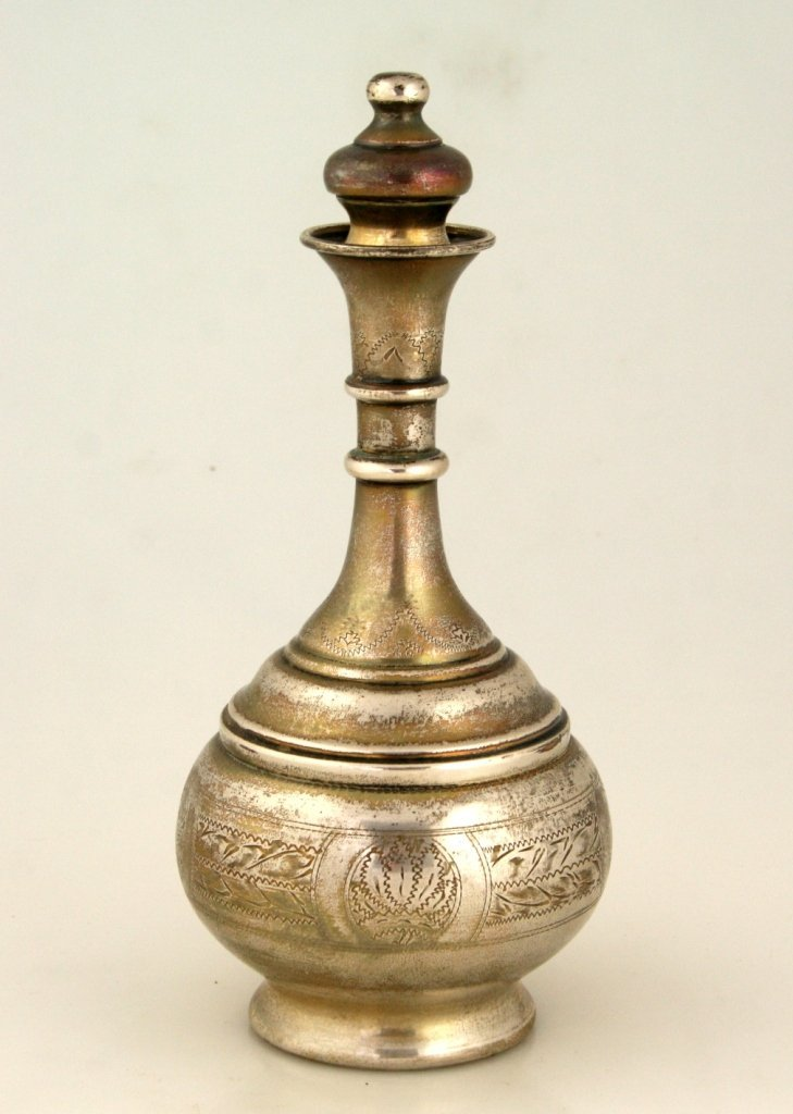 A LARGE STERLING SILVER WINE BOTTLE. United States, c.1