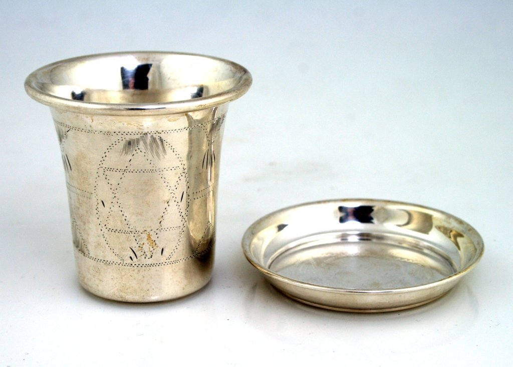 A LARGE STERLING KIDDUSH CUP AND UNDERPLATE. United Sta