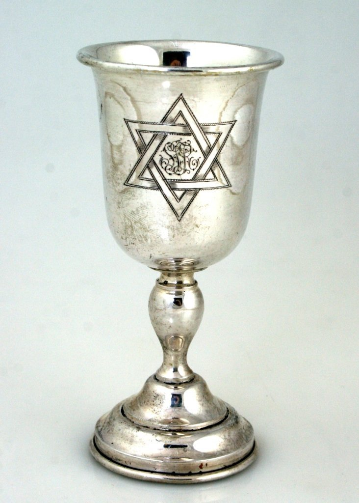 A SILVER KIDDUSH GOBLET. Germany, c. 1900. With central