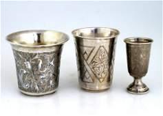 THREE SILVER KIDDUSH CUPS. Russian, 19th century. The f