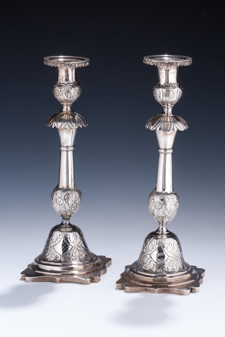 A PAIR OF EARLY SILVER SABBATH CANDLESTICKS. Russia, c.