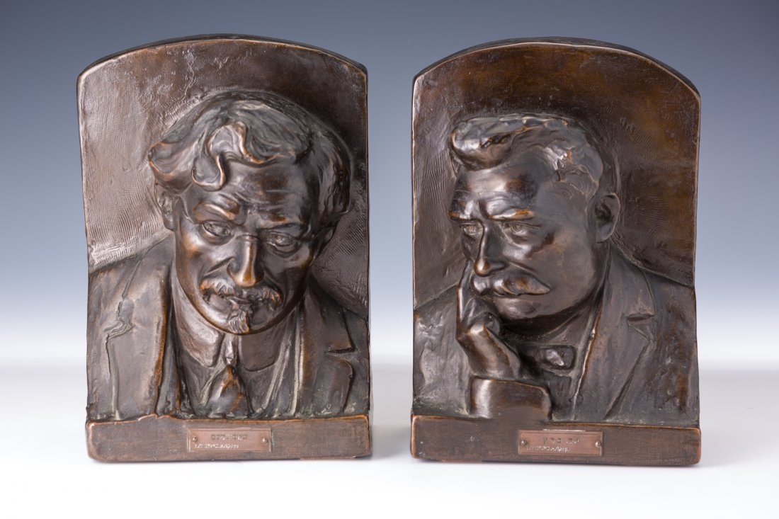 AN EXCEPTIONALLY RARE PAIR OF POMPEIAN BRONZE BOOKENDS.
