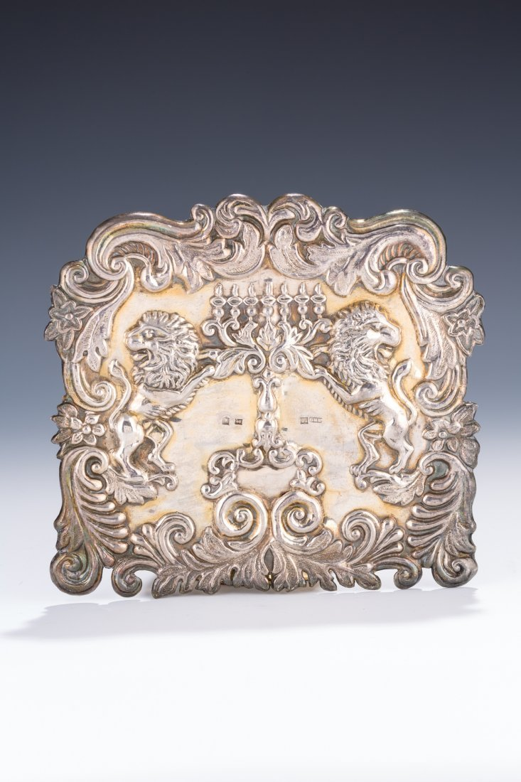 A SILVER TORAH SHIELD. Vilna, 1873. Chased with two