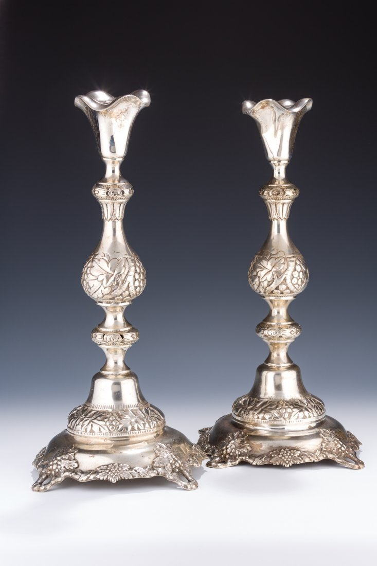 A PAIR OF MONUMENTAL SILVER CANDLESTICKS BY IZAAK