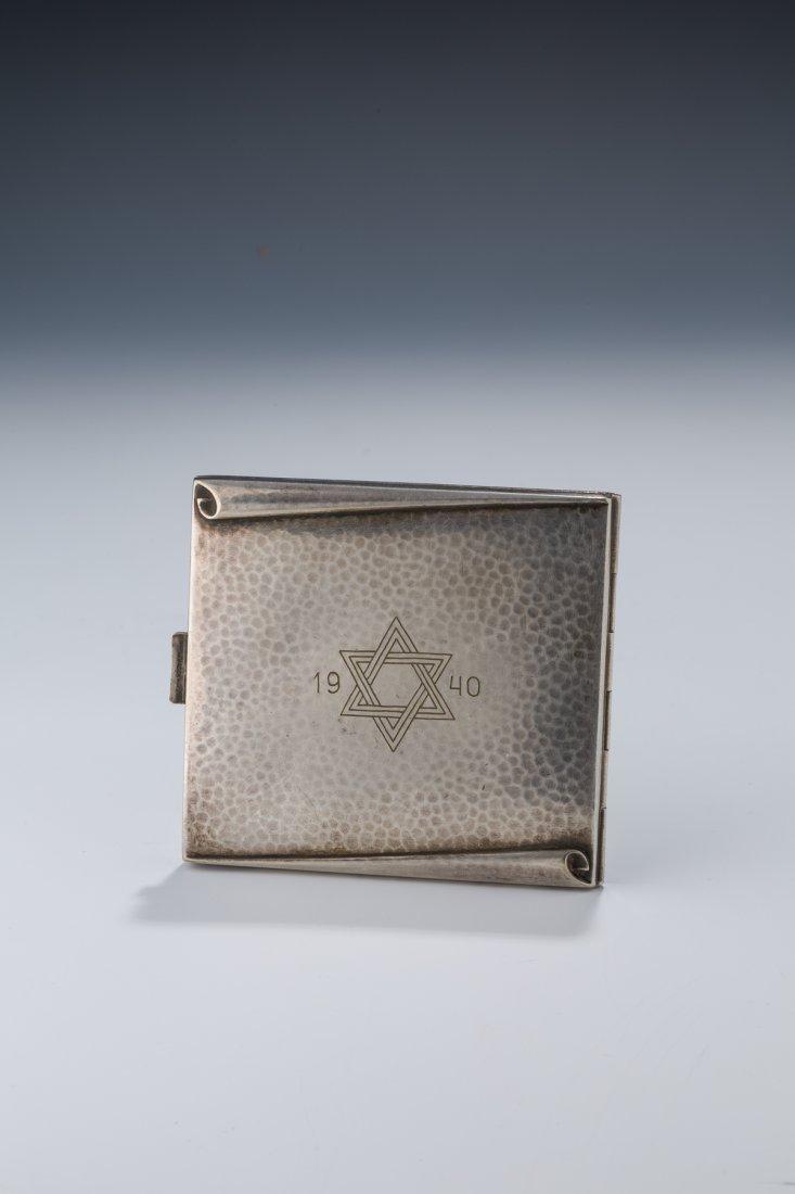A HAND HAMMERED CIGARETTE BOX FROM THE LITZMANNSTADT