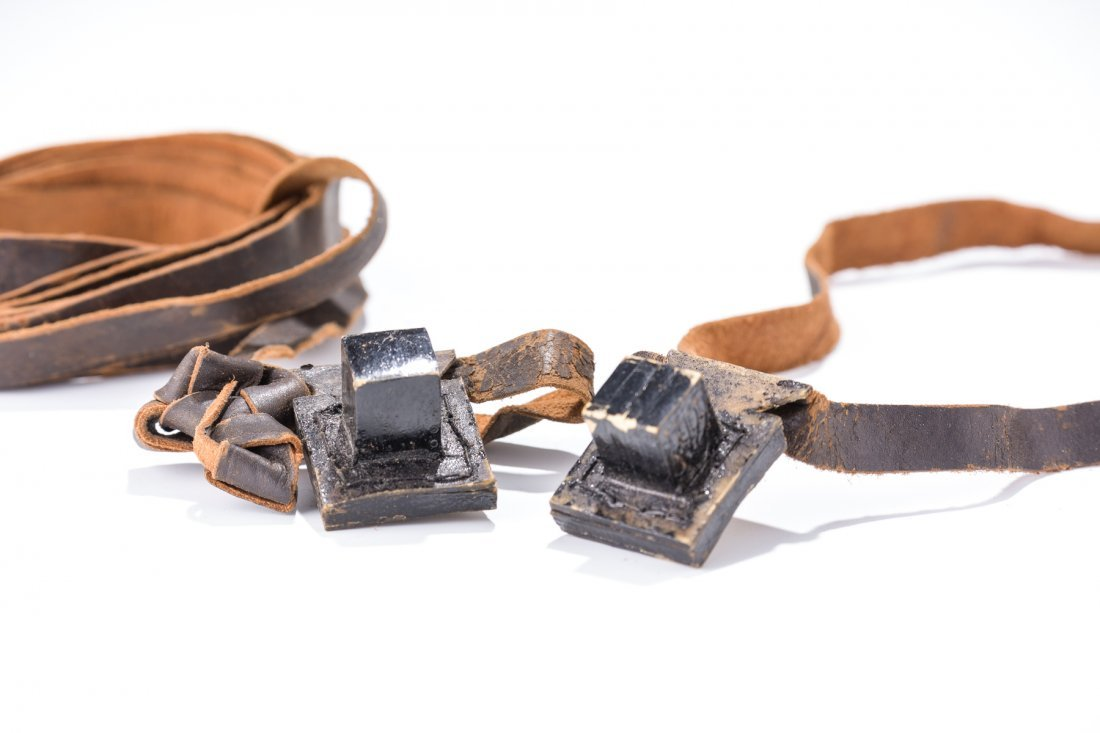 A RARE SET OF MINIATURE TEFILLIN WITH STRAPS. Probably