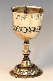 A SILVER KIDDUSH CUP. Germany, c. 1900. Octagonal.
