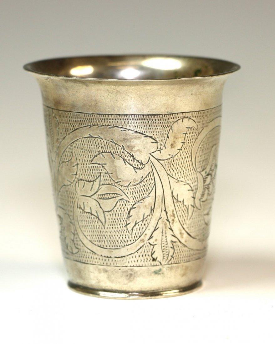 A SILVER KIDDUSH CUP. Poland, c. 1840. On flat base