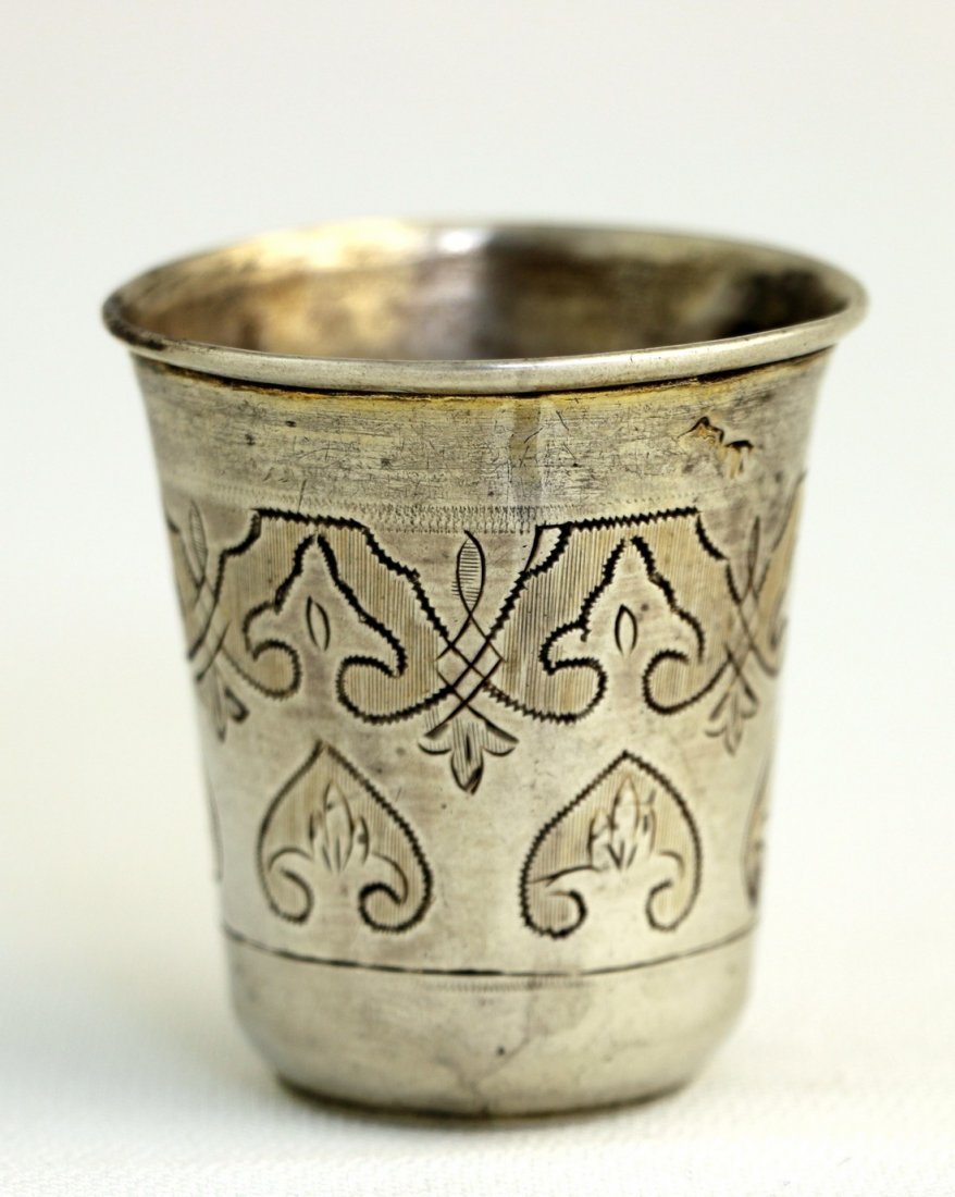 A SILVER BEAKER. Russian, c. 1884. Hand engraved with