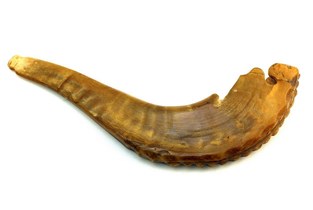 AN ANTIQUE CARVED SHOFAR. Germany, c. 1840. Hand carved
