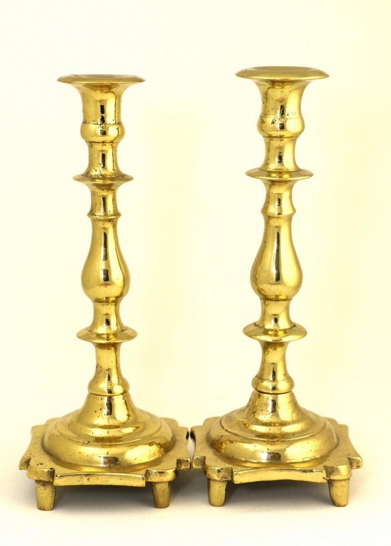 A PAIR OF BRASS SABBATH CANDLESTICKS. Poland or Russia,