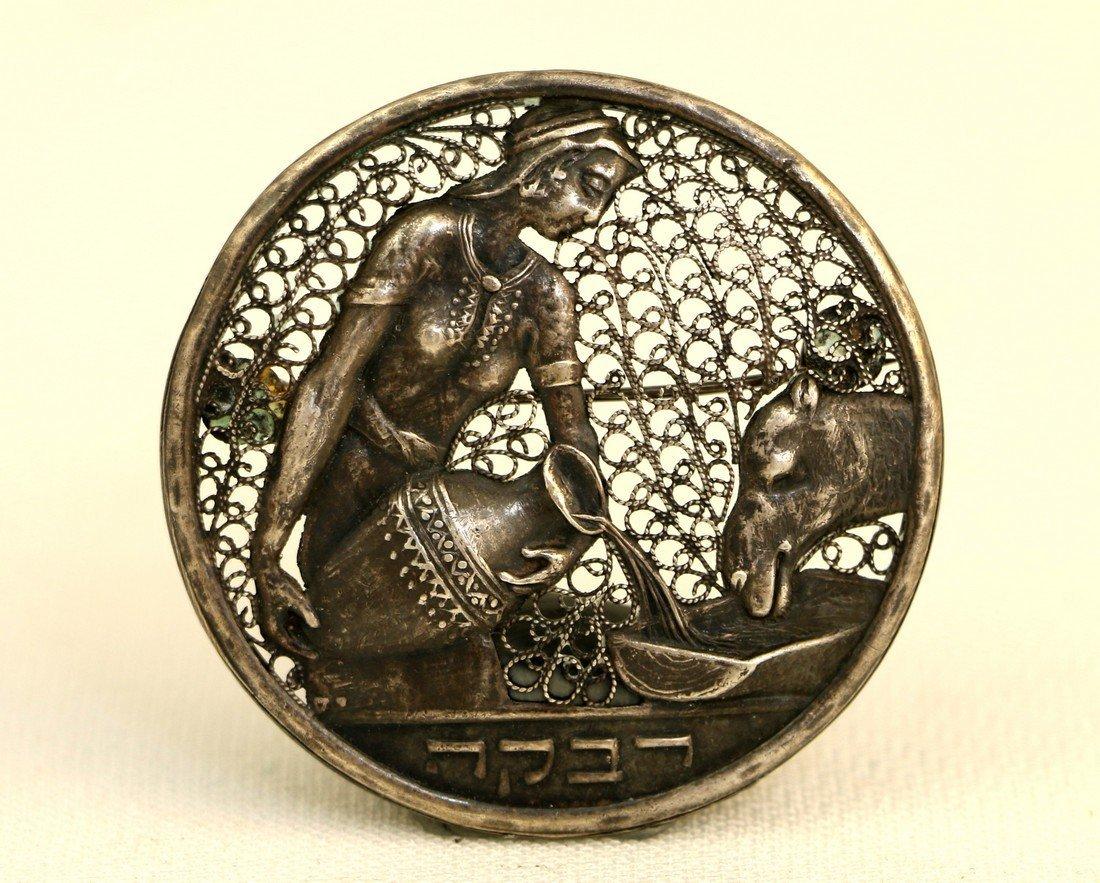 A SILVER FILIGREE PIN OF REBECCA. Palestine, c. 1930.