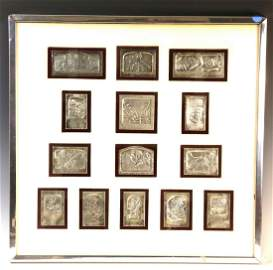 A GROUP OF 14 SILVER PLAQUES BY BORIS SCHATZ. Mounted