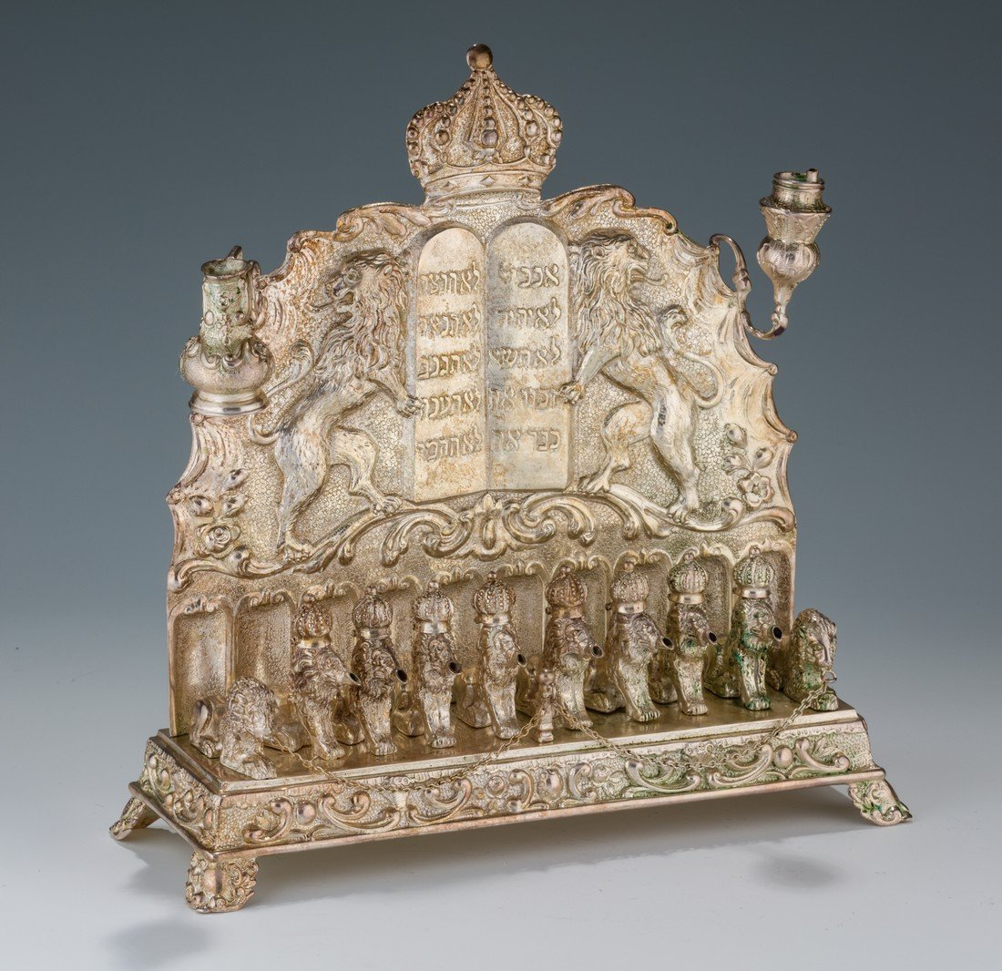 A SILVER CHANUKAH LAMP. Germany, c. 1880. On four