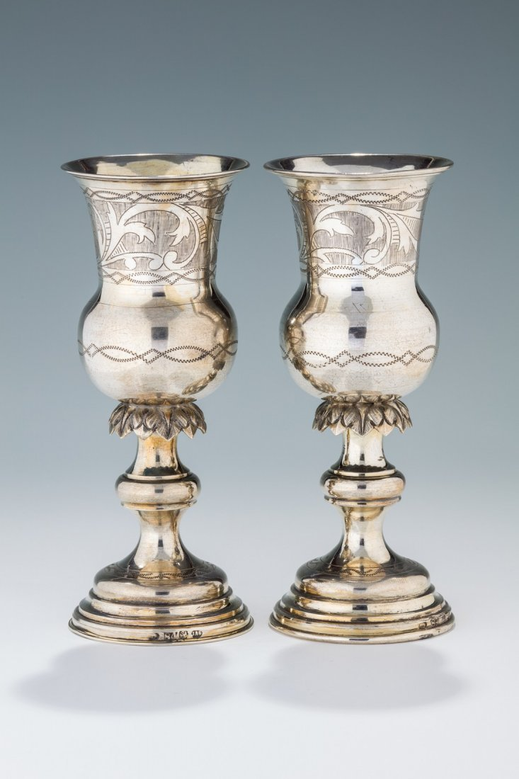 A PAIR OF EARLY SILVER KIDDUSH CUPS BY ISAAC GOLDMAN.