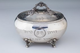 A Silver Etrog Container. Poland, C. 1880. On Four Feet