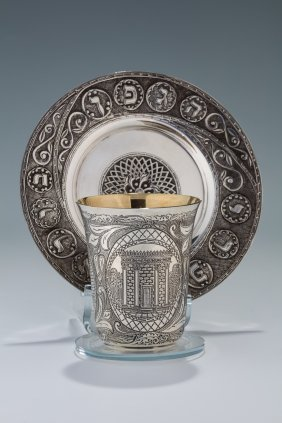 A Sterling Silver Kiddush Cup And Underplate By