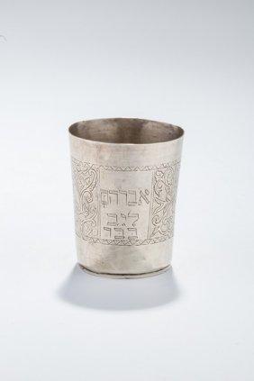 A Silver Kiddush Beaker. Poland, C. 1840.