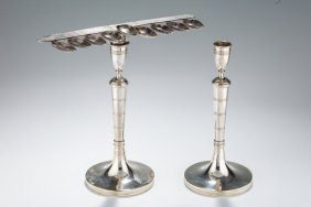 A Silver Chanukah Menorah Candlestick Combination.
