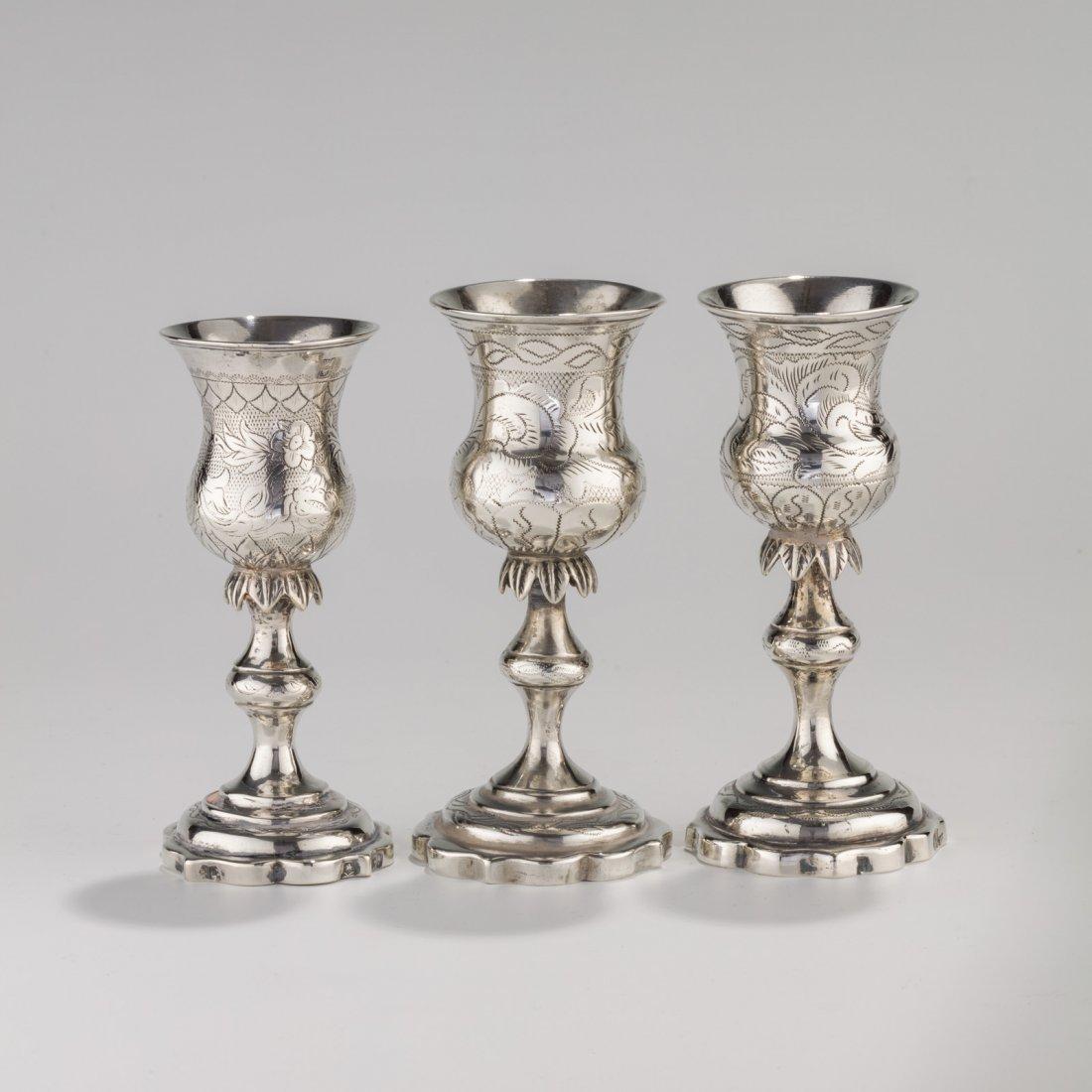 THREE SILVER KIDDUSH GOBLETS. Vilna, 19th century. Each