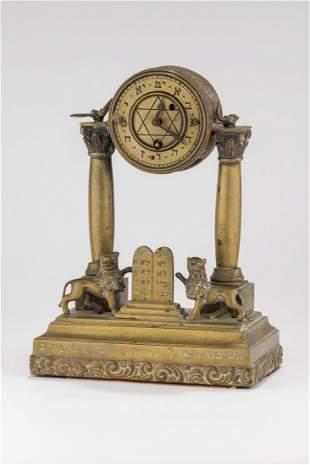 A BRASS FIREPLACE CLOCK. Prague, c. 1880. On