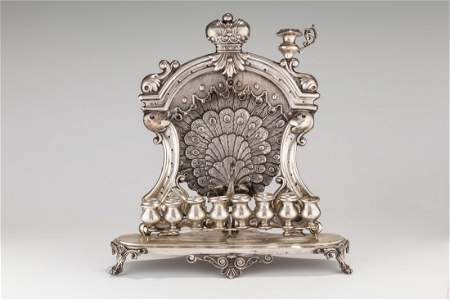 A SILVER CHANUKAH LAMP. Vienna, 19th century. On oval