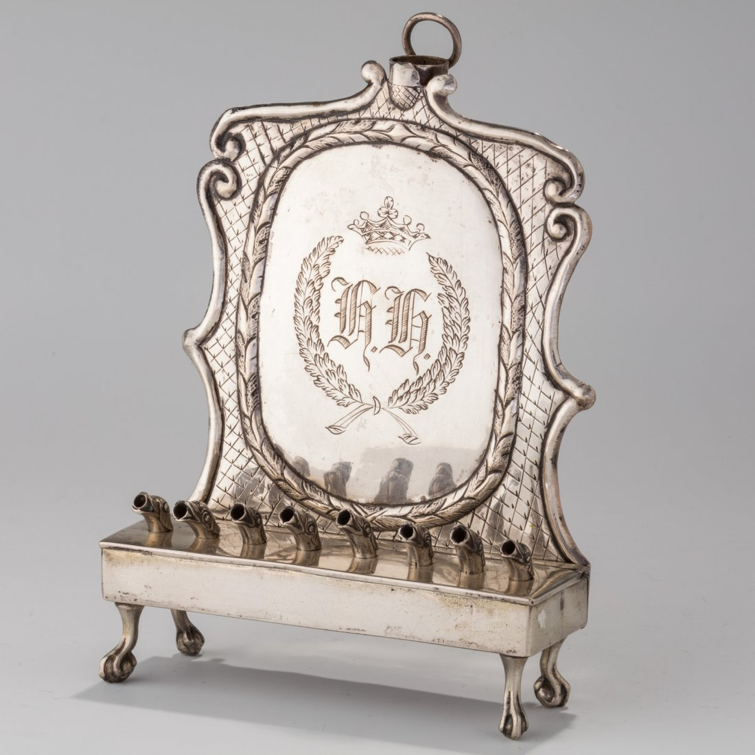 A SILVER CHANUKAH LAMP. Poland, Early 19th century. In