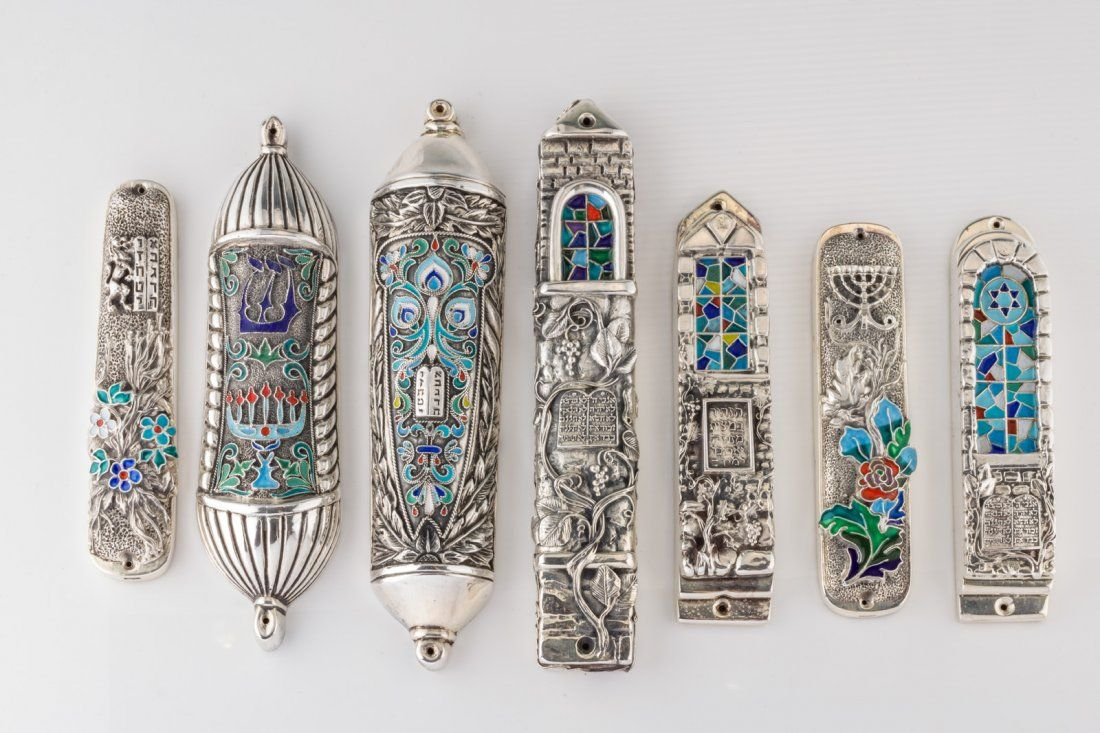 A GROUP OF SEVEN SILVER MEZUZOT BY HENRYK WINOGRAD. New