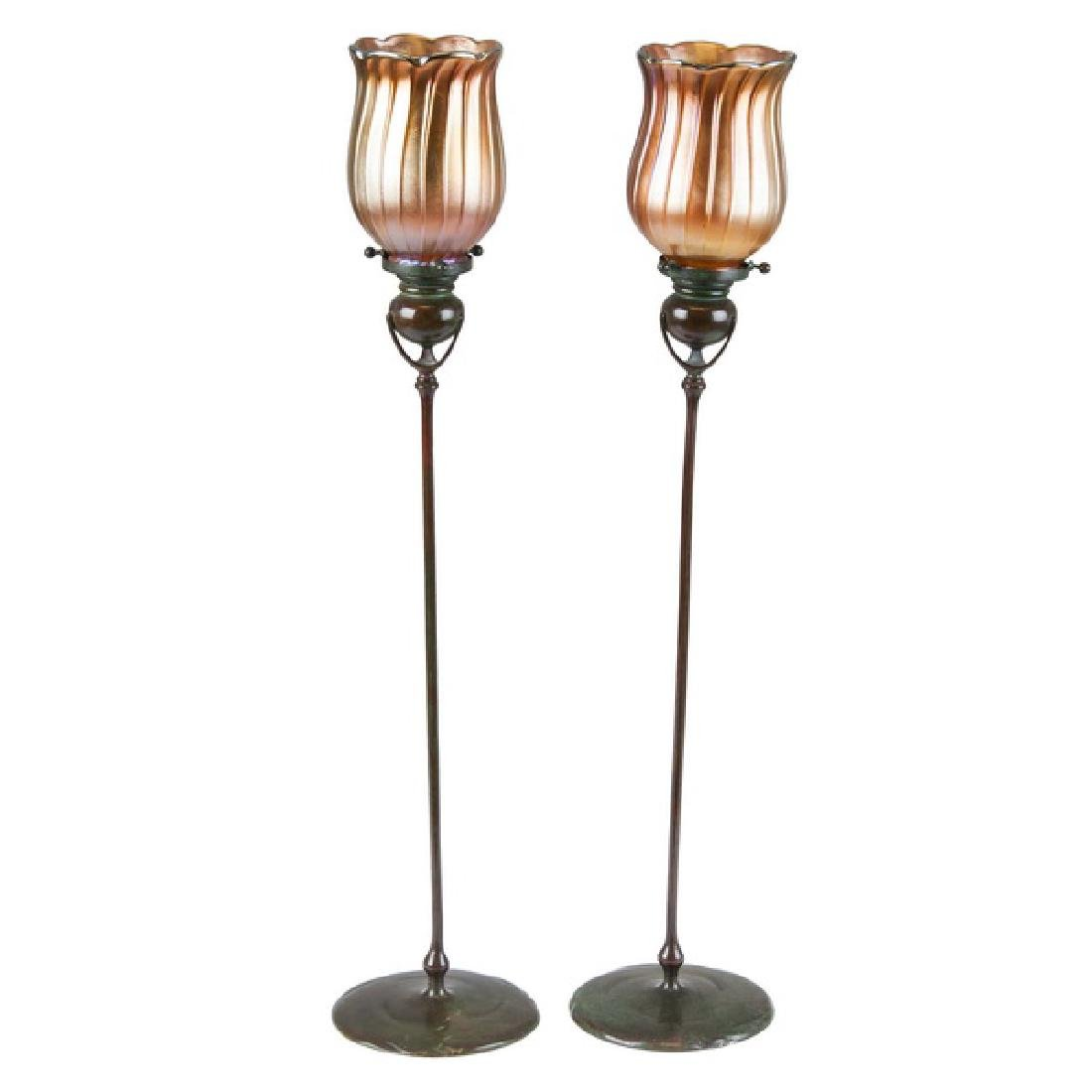 PAIR OF TIFFANY STUDIOS BRONZE CANDLESTICKS WITH ART