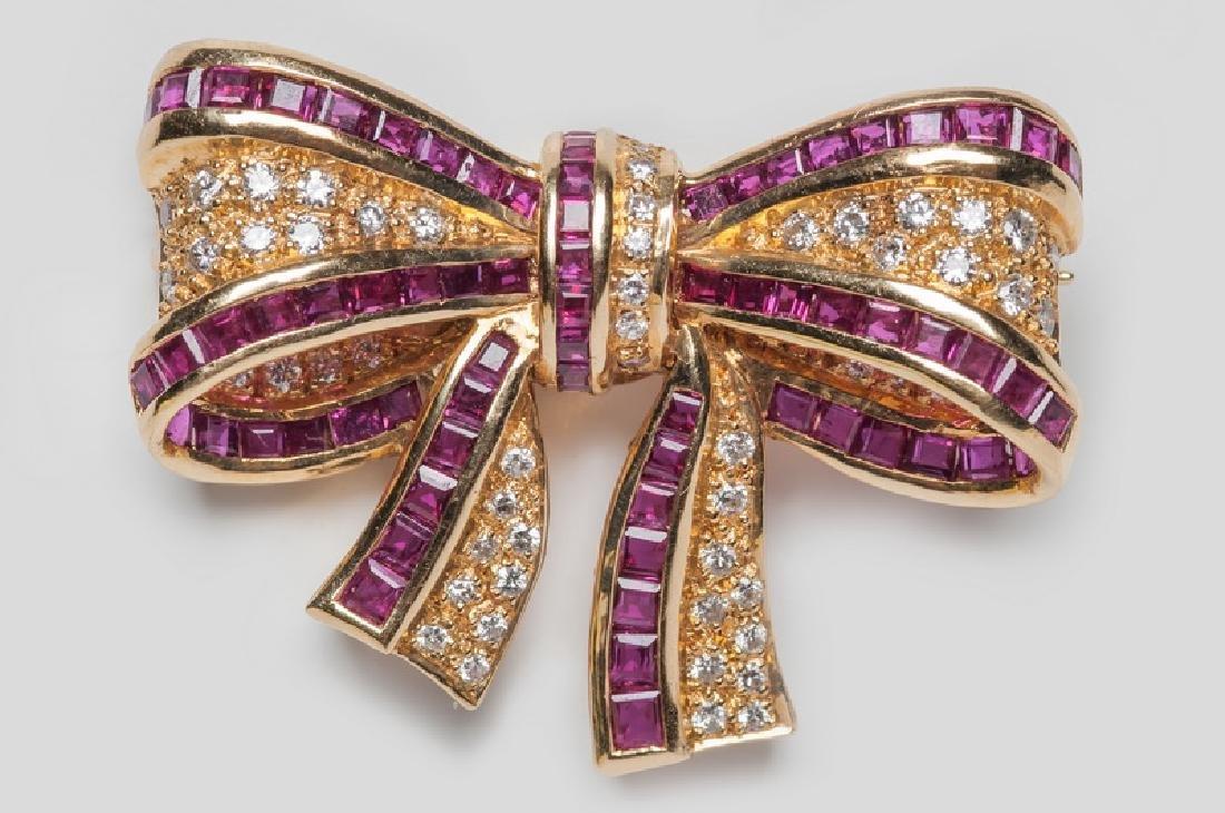 18 KARAT GOLD, DIAMOND, & RUBY BOW BROOCH