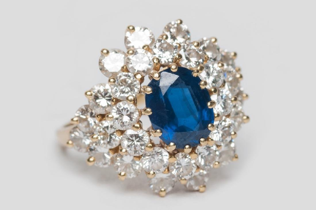 18 KARAT GOLD, SAPPHIRE, & DIAMOND COCKTAIL RING