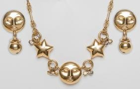 18 KARAT YELLOW & WHITE GOLD MOON AND STARS NECKLACE