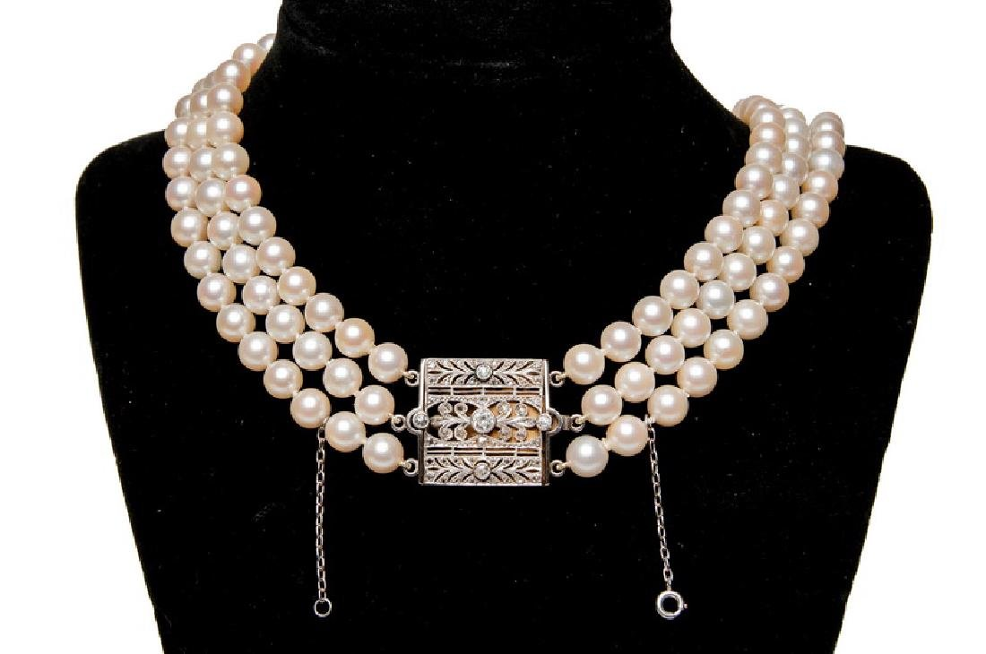 THREE-STRAND UNIFORM PEARL NECKLACE