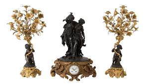 FRENCH GILT  PATINATED BRONZE THREE PIECE CLOCK SET